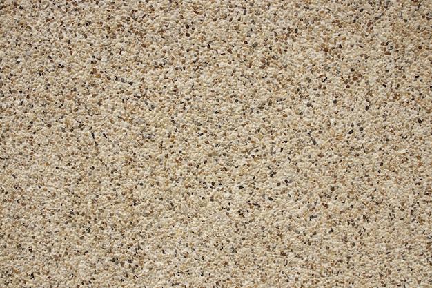 Fondo di struttura del pavimento di piastrelle di pietra di ciottoli grigi.