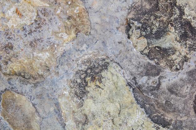 Struttura grigia del vecchio muro di roccia per lo sfondo