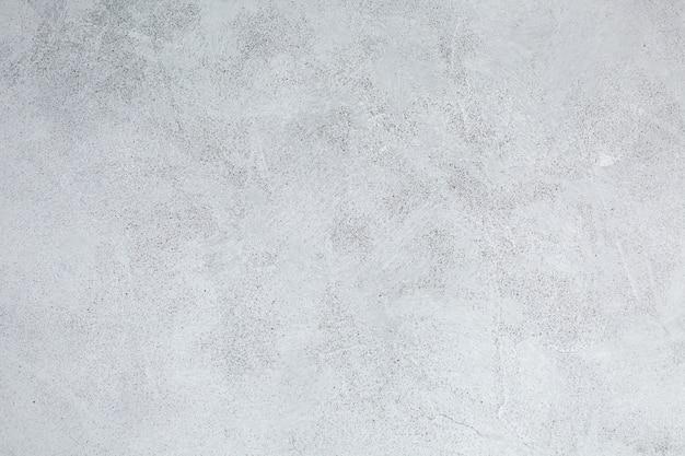 Fondo ruvido di struttura dell'ardesia di lerciume del vecchio muro grigio