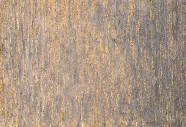Grigio con fondo di struttura di legno di colore giallo