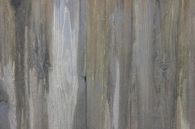 Struttura e fondo di legno grigi del bordo.