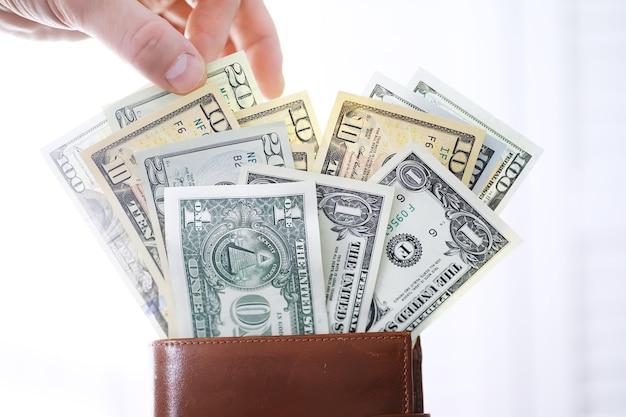 Gruppo di soldi pila di 100 dollari us banconote un sacco di texture di sfondo. denaro contante in una grande pila come sfondo finanziario.