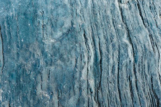 Grunde fondo di pietra astratto. la trama della pietra. texture in primo piano
