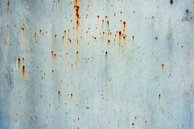 Fondo blu di struttura del ferro di lerciume, fondo del metallo con i graffi. vecchia struttura di superficie graffiata arrugginita di lerciume blu del metallo