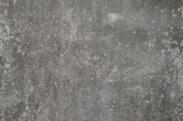 Muro di cemento incrinato grigio sporco di lerciume