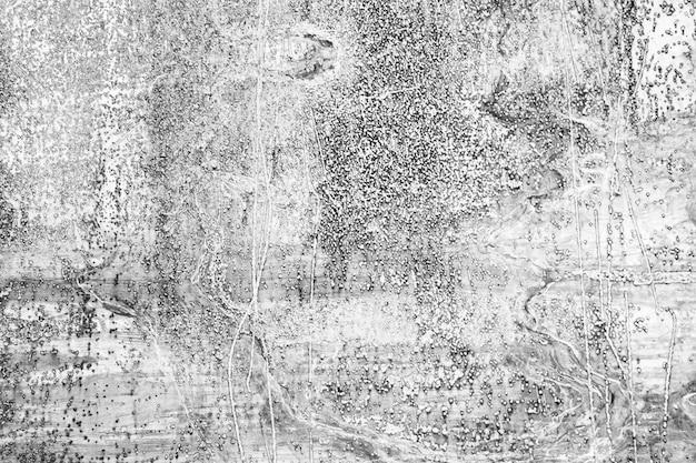 Fondo in bianco e nero del metallo di lerciume