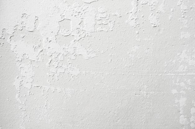 Bianco sgangherato di cemento naturale o vecchia struttura di pietra
