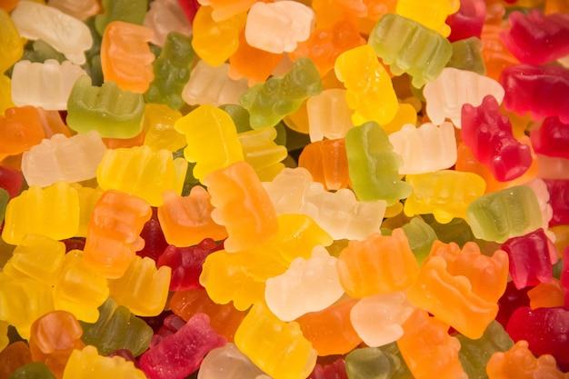 Sfondo di orsetti gommosi. sfondo di dolci. orsetti gommosi. sfondo multicolore.
