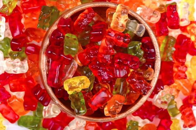 Orsetti gommosi sfondo colorato caramelle gustose