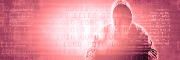 Hacker stampa un codice sulla tastiera di un laptop per entrare in un cyberspazio
