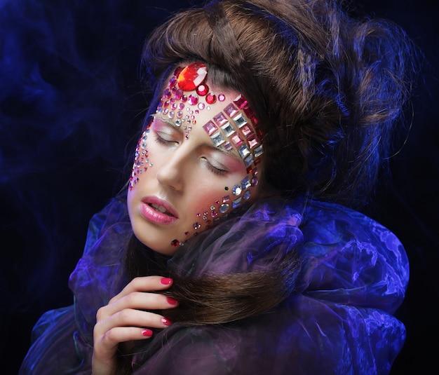 Trucco della donna di stile di bellezza di halloween, sogno di fantasia.