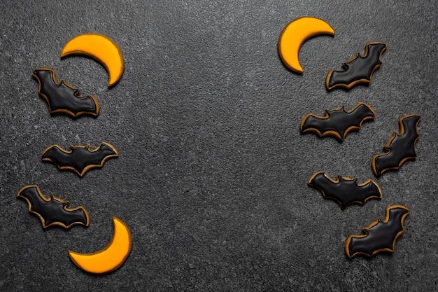 Biscotti di halloween pipistrelli su sfondo grigio copia spazio