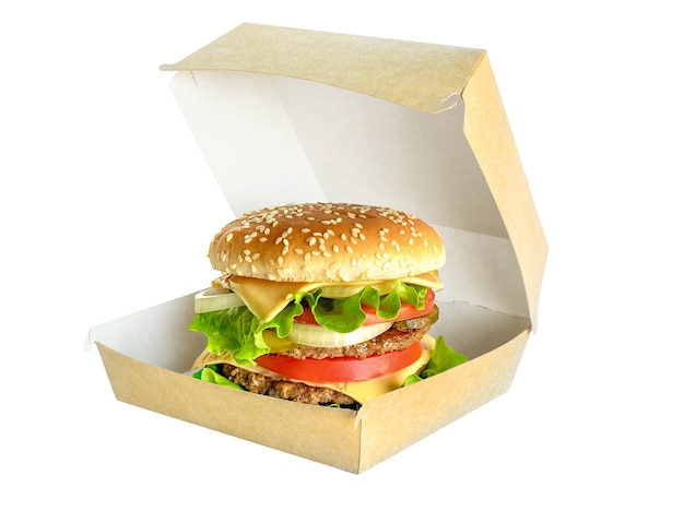Hamburger in scatola di cartone isolato su sfondo bianco. doppio grande hamburger gustoso in confezione