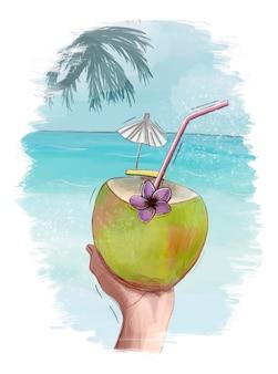 In mano una noce di cocco con una cannuccia e un fiore sullo sfondo dell'oceano e della palma. estate, turismo e concetto di viaggio.