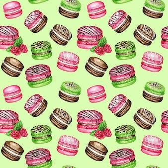 Reticolo senza giunte di torte macaron francese dell'acquerello disegnato a mano. cioccolato, vaniglia, frutta dessert di pasticceria su sfondo verde amaretti colorati, verde menta rosa lampone dolce trama del tessuto.
