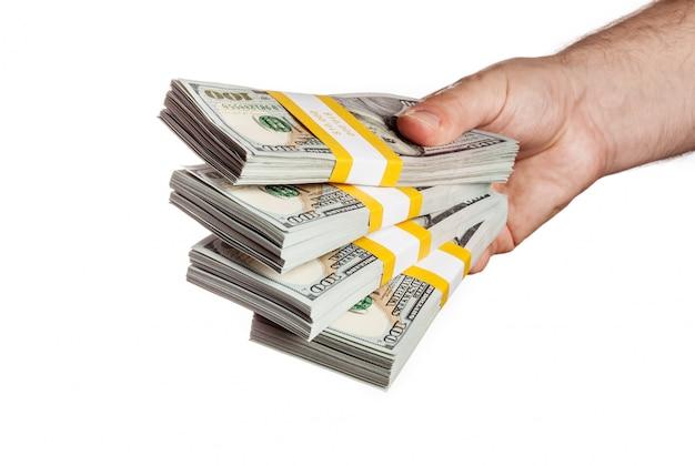 Mano che tiene fasci di banconote da 100 usd edizione 2013