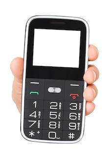 Mano che tiene un semplice telefono cellulare a barra con pulsanti e schermo vuoto isolato
