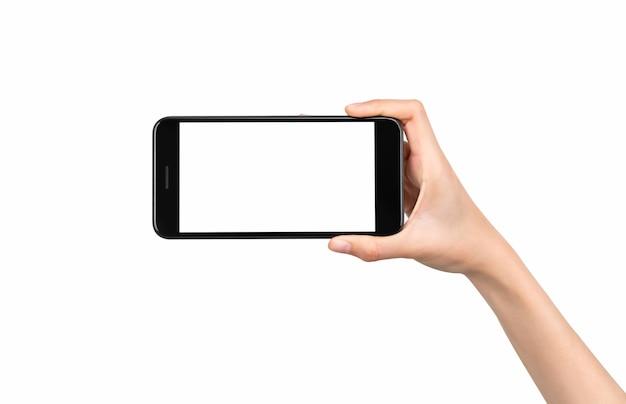 Mano che tiene il modello di smartphone dello schermo vuoto su isolato. prendi il tuo schermo per mettere sulla pubblicità.