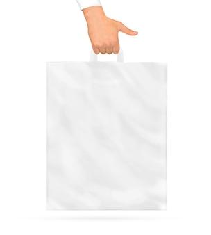 Mano che tiene un sacchetto di plastica bianco