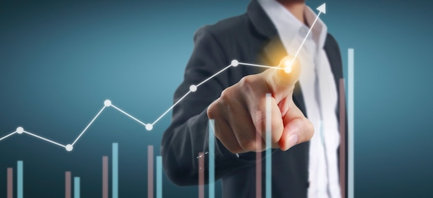 Mano che tocca i grafici dell'indicatore finanziario e del grafico di analisi dell'economia di mercato di contabilità