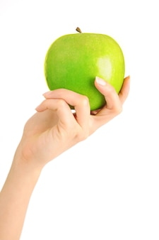 Mano con la mela isolata su priorità bassa bianca
