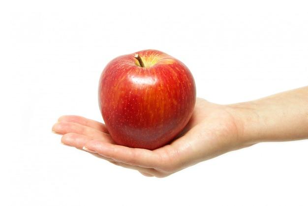 Mano con mela