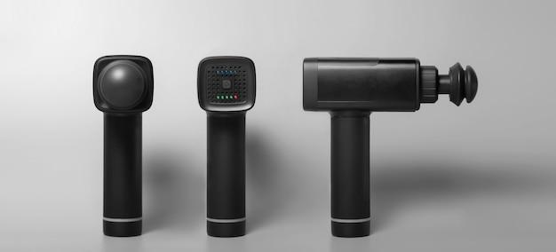 Pistola per massaggio shock terapeutico professionale wireless portatile su superficie grigia