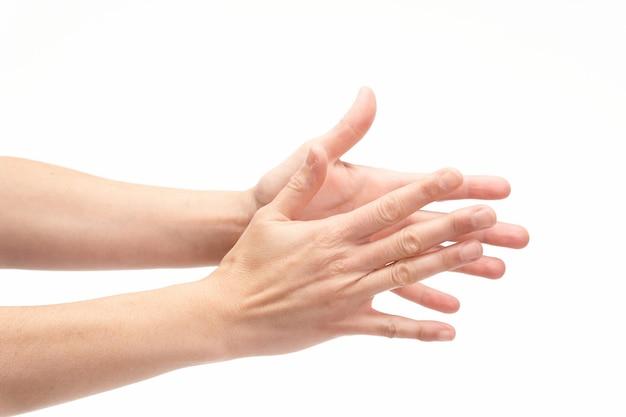 Mani che applaudono su sfondo bianco, copia dello spazio