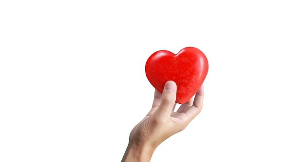 Mani che tengono un cuore rosso. la salute del cuore. e concetti di donazione