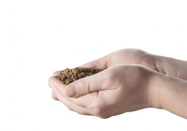 Mani con terreno su bianco isolato