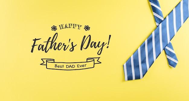 Concetto di sfondo per la festa del papà felice realizzato con una bella cravatta su sfondo giallo pastello