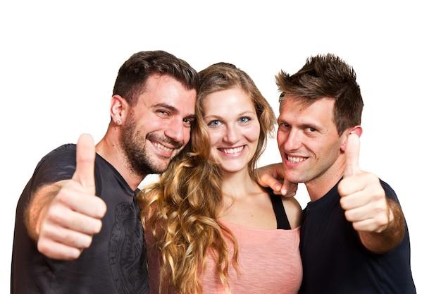 Felice gruppo di amici isolato su bianco Foto Premium