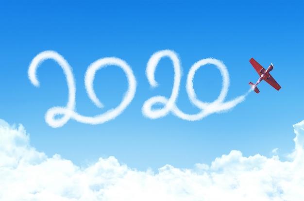 Felice anno nuovo 2020 testo disegno da scia di condensazione di vapore bianco aereo passeggeri nel cielo.