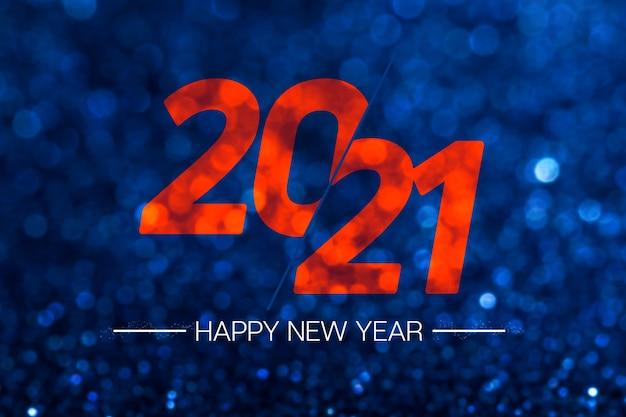 Felice anno nuovo 2021 con luce bokeh glitter blu scuro scintillante