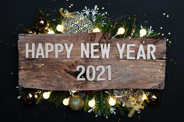 Felice anno nuovo 2021 su un legno