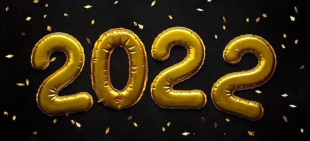 Palloncini d'oro per la celebrazione del buon anno in forma