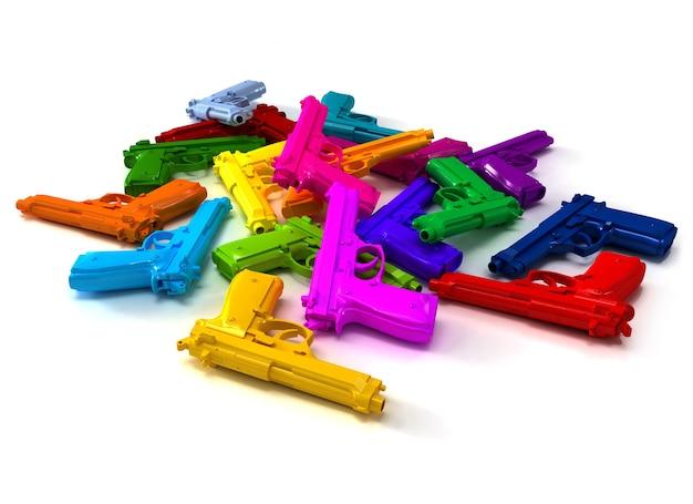 Mucchio di pistole dai colori vivaci che giace su una superficie bianca