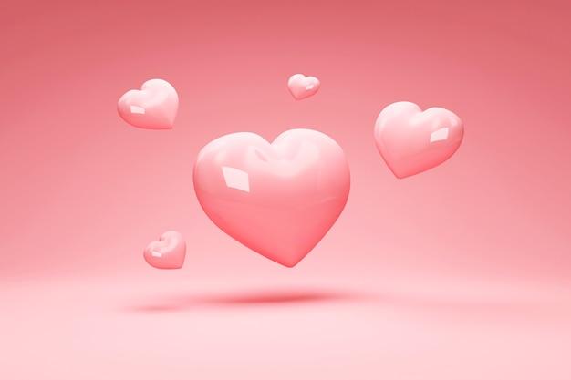 Mucchio di cuori d'amore su sfondo rosa studio