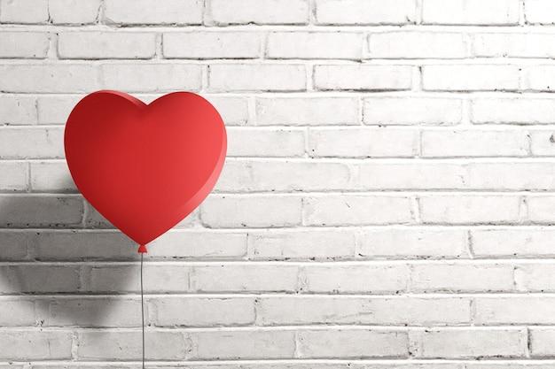 Palloncino cuore con sfondo muro di mattoni. san valentino