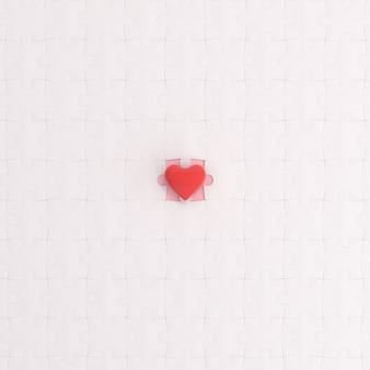 Il cuore è sul puzzle bianco.