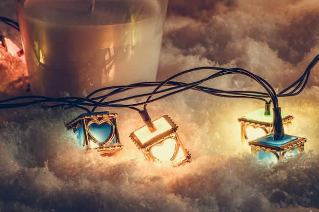 Lampadina del cuore e candela bianca di natale, ornamento decorare buon natale