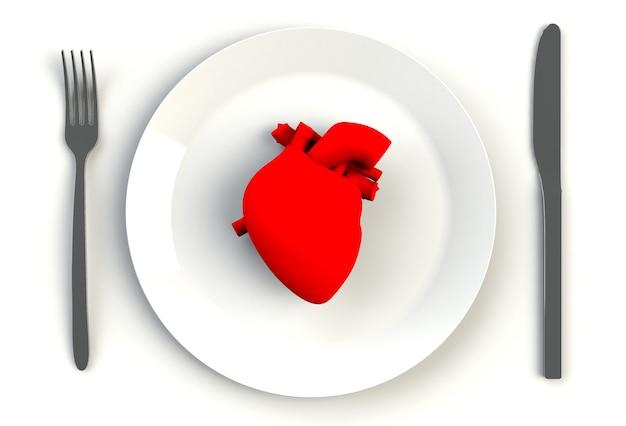 Cuore sul piatto, sul coltello e sulla forcella sulla tavola bianca, rappresentazione 3d