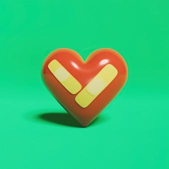 A forma di cuore con nastro adesivo di recupero medico sulla superficie verde