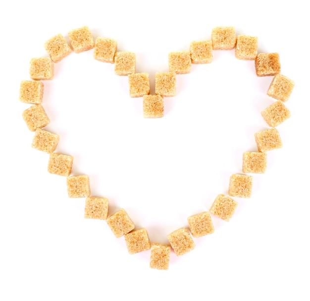Fette biscottate a forma di cuore isolate su bianco Foto Premium