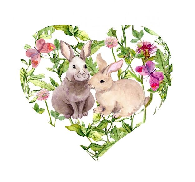 Cuore con coppia di conigli, erba di campo, fiori di campo, erbe estive e farfalle. acquerello per san valentino, matrimonio, salva la data card