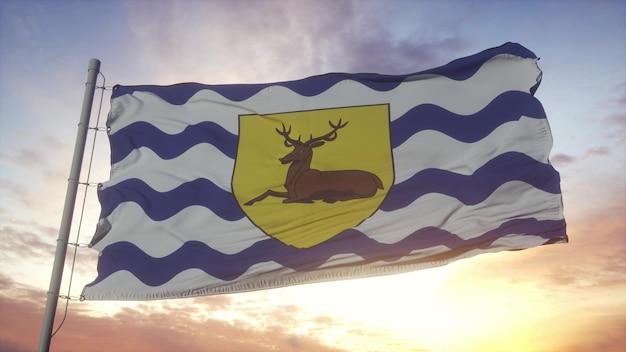 Bandiera dell'hertfordshire, inghilterra, che fluttua nel vento, nel cielo e nello sfondo del sole. rendering 3d