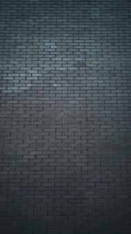 Alto muro di mattoni neri