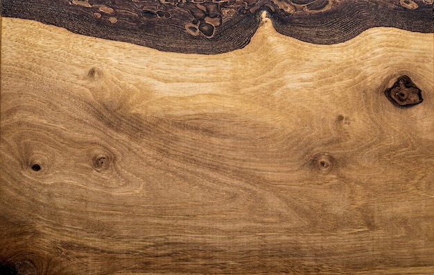 Una trama ad alta risoluzione della scrivania in legno di quercia marrone