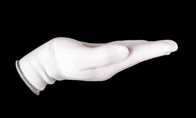 La mano stretta nel guanto bianco su sfondo nero.