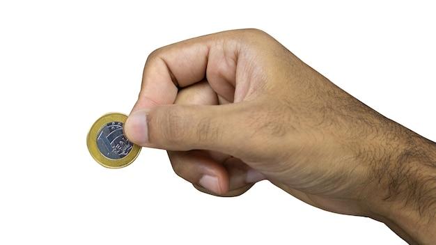 Tenendo soldi veri brasiliani isolati su priorità bassa bianca. nota maschio della tenuta della mano dei contanti. spazio per il testo.